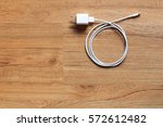 cable phone chargers on wood... | Shutterstock . vector #572612482