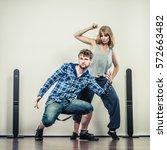 two modern dancers couple woman ... | Shutterstock . vector #572663482