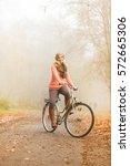 happy active woman riding bike... | Shutterstock . vector #572665306