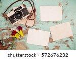 retro camera and empty old... | Shutterstock . vector #572676232
