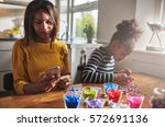 busy african american parent in ... | Shutterstock . vector #572691136