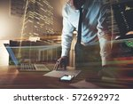 serious business man working on ... | Shutterstock . vector #572692972