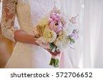 bride holding delicate marriage ... | Shutterstock . vector #572706652