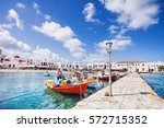fishing boats in mykonos town ... | Shutterstock . vector #572715352