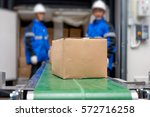 package boxes from conveyor...   Shutterstock . vector #572716258