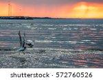 beautiful sunset at seaside.... | Shutterstock . vector #572760526