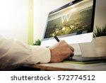 web developer designing a... | Shutterstock . vector #572774512