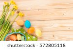 happy easter  narcissus flowers ... | Shutterstock . vector #572805118