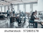 successful team at work. group... | Shutterstock . vector #572805178
