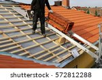 new roof construction on a... | Shutterstock . vector #572812288