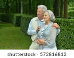 senior couple in autumn park | Shutterstock . vector #572816812