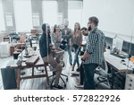 cooperation in action.  group... | Shutterstock . vector #572822926