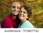 loving mother and son | Shutterstock . vector #572827732