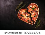 heart shaped pizza with... | Shutterstock . vector #572831776