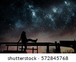 girl watching the stars in... | Shutterstock . vector #572845768