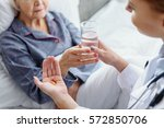 physician holding drug and... | Shutterstock . vector #572850706