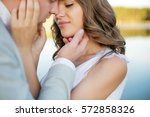 young couple embracing. st.... | Shutterstock . vector #572858326