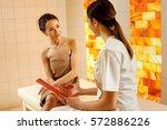 beautiful woman having a... | Shutterstock . vector #572886226