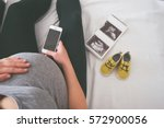 young pregnant woman relaxing... | Shutterstock . vector #572900056
