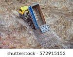 truck unloads rubble to the... | Shutterstock . vector #572915152