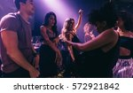 Stock photo group of friends dancing in club young men and women having fun at disco nightclub 572921842