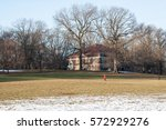 building and snowy field in... | Shutterstock . vector #572929276