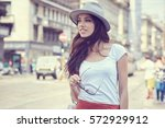 fashionably dressed woman on... | Shutterstock . vector #572929912