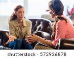 psychologist having session... | Shutterstock . vector #572936878