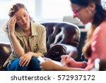 psychologist having session... | Shutterstock . vector #572937172