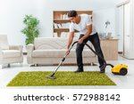 man husband cleaning the house... | Shutterstock . vector #572988142