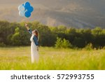 young happy woman holding many... | Shutterstock . vector #572993755