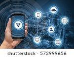 hand holding smart phone ... | Shutterstock . vector #572999656