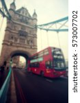 tower bridge with red bus in... | Shutterstock . vector #573007702