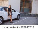 two beautiful girls walking... | Shutterstock . vector #573017512