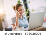 young smiling businesswoman on... | Shutterstock . vector #573025006