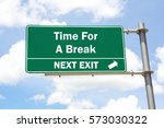 green overhead road sign with a ... | Shutterstock . vector #573030322