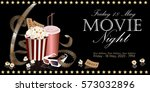 popcorn box with film reel ... | Shutterstock .eps vector #573032896