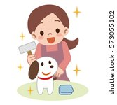 young lady brushing a dog | Shutterstock .eps vector #573055102