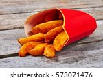red cardboard box of fries.... | Shutterstock . vector #573071476