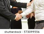 business handshake. cropped... | Shutterstock . vector #573099556