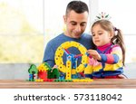 Father And Daughter Are Playing With Toys At Home - stock photo