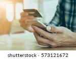online payment man's hands... | Shutterstock . vector #573121672