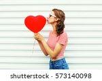 pretty woman making air kiss... | Shutterstock . vector #573140098
