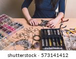 young jewelry designer making... | Shutterstock . vector #573141412