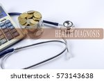 a stethoscope with piles of... | Shutterstock . vector #573143638