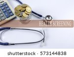 a stethoscope with piles of... | Shutterstock . vector #573144838