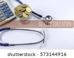 a stethoscope with piles of... | Shutterstock . vector #573144916