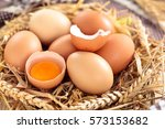 farmers eggs in straw and... | Shutterstock . vector #573153682