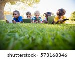 kids using technology during a... | Shutterstock . vector #573168346