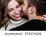 Stock photo young couple in love hug each other on the black background 573174106